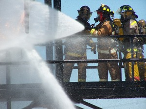 Fire fighters spraying Opens in new window