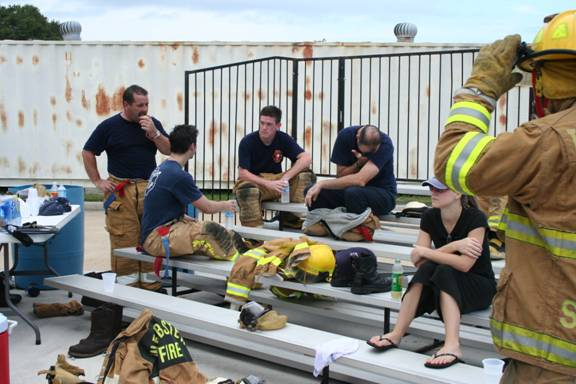 Fire fighters sitting on bleachers