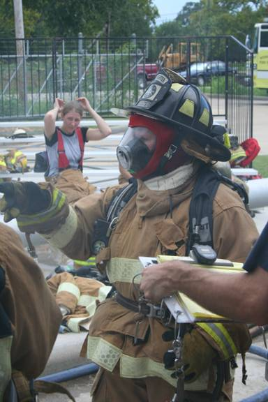 Fire fighters putting on suits