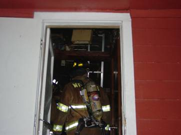 Fire fighters entering building