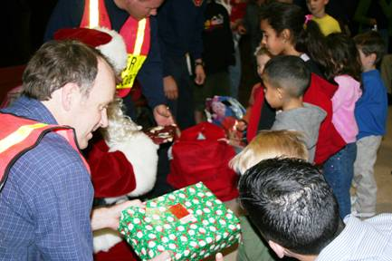 Santa Claus with officers and children