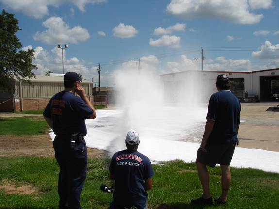 Fire fighters spraying fire hoses