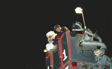 Santa Claus with officer in fire truck